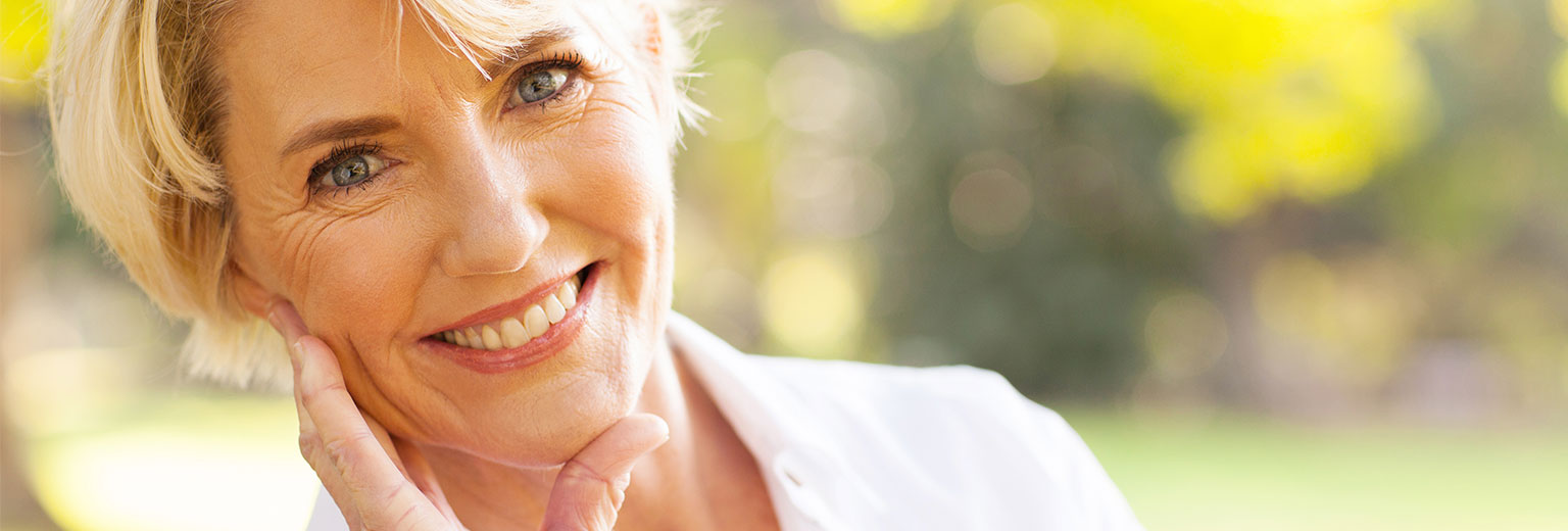Happy woman after having tooth repair